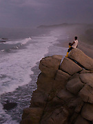 A hiker enjoys an overlook in Tayrona National Park - Colombia