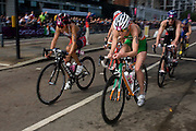 Canada's Cathy Tremblay (#56, left) and Aileen Morrison (#28, right) in the cycling phase of the womens' Triathlon held in Hyde Park during the London 2012 Olympics. The race was eventually won in a photo finish by the Swiss Nicola Spirig, Lisa Norden (Silver) and Australia's Erin Densham (Bronze)