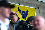 Oxford United flag and fans during the EFL Sky Bet League 1 match between Burton Albion and Oxford United at the Pirelli Stadium, Burton upon Trent, England on 2 February 2019.