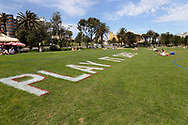 A large sign is seen painted on the grass at St Kilda Beach reminding locals to 'Play it Safe' during COVID-19 in Melbourne, Australia. Premier Daniel Andrews comes down hard on Victorians breaching COVID 19 restrictions, threatening to close beaches if locals continue to flout the rules. This comes as Victoria sees single digit new cases. (Photo by Dave Hewison/Speed Media)