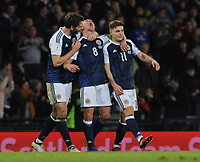 Football - 2016 / 2017 World Cup Qualifier - UEFA Group F: Scotland vs. Slovenia<br /> <br /> Scott Brown of Scotland celebrates with Charlie Mulgrew and James Forrest after the match at Hampden Park.<br /> <br /> COLORSPORT