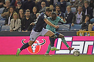 Millwall defender Ryan Leonard  (18)  and Leicester City Forward Ademola Lookman (37) battles for possession during the EFL Cup match between Millwall and Leicester City at The Den, London, England on 22 September 2021.