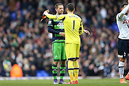Gylfi Sigurdsson of Swansea City hugs Goalkeeper Hugo Lloris of Tottenham Hotspur after the final whistle. Barclays Premier league match, Tottenham Hotspur v Swansea city at White Hart Lane in London on Sunday 28th February 2016.<br /> pic by John Patrick Fletcher, Andrew Orchard sports photography.