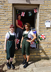 © Paul Thompson licensed to London News Pictures. 16/05/2015. Haworth, West Yorkshire, UK. Three women in a pop up cafe at Haworth 1940s weekend, an annual event in which people dress in period costume and visit the village of Haworth to relive the 1940s. Photo credit : Paul Thompson/LNP