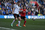 Fulham's John Arne Riise (l) holds off Cardiff's Fabio Da Silva. Barclays Premier league, Cardiff city v Fulham at the Cardiff city Stadium in Cardiff , South Wales on Sat 8th March 2014. pic by Andrew Orchard, Andrew Orchard sports photography