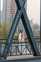 Shanghai, China - April 10, 2013: young wedding bride on The Waibaidu Bridge at the city of Shanghai in China on april 10th, 2013