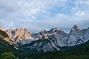 "The mountain of Siroka pec (2497 meters/8192 feet) rises high in the Martuljek mountain group in Triglav National Park (Triglavski narodni park, TNP) in the Julian Alps, above the town of Gozd Martuljek (""Martuljek Forest""), Slovenia, Europe. Latitude/Longitude: 46.45000°N / 13.85000°E. Slovene letters in ""?iroka pe?"" may not appear in some media."