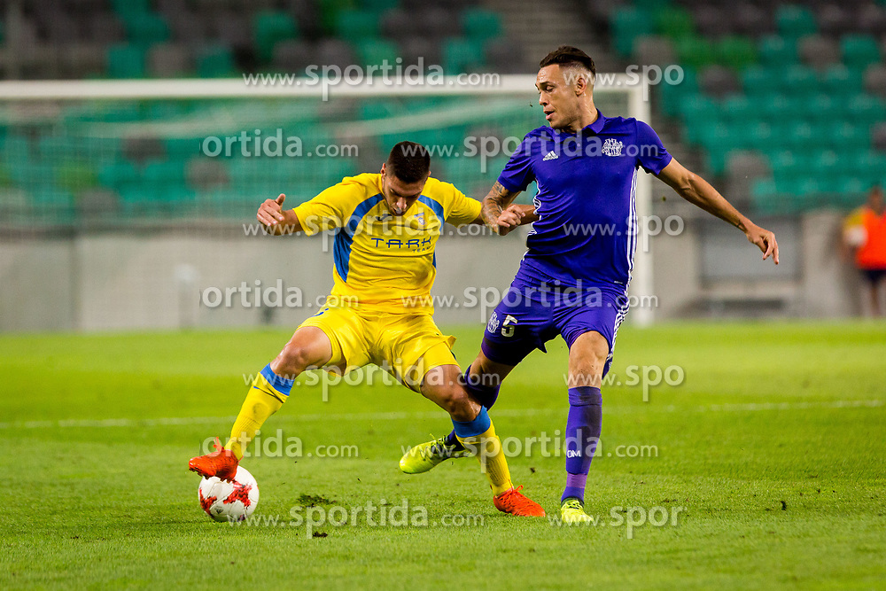 Matija Sirok of NK Domzale and Lucas Ocampos of Olympic Marseille during football match between NK Domzale and Olympique de Marseille in First game of UEFA Europa League playoff round, on August 17, 2017 in SRC Stozice, Ljubljana, Slovenia. Photo by Ziga Zupan / Sportida