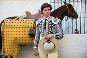 A Mexican Picador waits as he horse is prepared for the bullfights at the Plaza de Toros in San Miguel de Allende, Mexico. Picadors ride horses surrounded by a peto, a mattress-like protection that greatly minimizes damage to the animal during the bullfight.