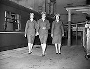 20/05/1959<br /> 05/20/1959<br /> 20 May 1959<br /> New C.I.E. Rail Hostesses - (l-r) Betty Vernon, (Bannagher, Co. Offaly); Mary O'Mara, (Dublin) and Deirdre McVeigh, (Cork) set off on a long journey from Kingsbridge Station (Hueston Station), Dublin.