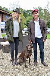 Richard Perlhagen and Triinu Raudsepp and dudley the dog at Young Guns raising money for the fight against breast cancer trough Cancer Research UK held at EJ Churchill Shooting School followed by lunch at West Wycombe Park, England. 23 September 2017.