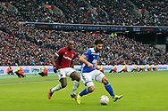 West Ham United midfielder Michail Antonio (30) battles for possession with Birmingham City defender Maxime Colin (5) during the The FA Cup 3rd round match between West Ham United and Birmingham City at the London Stadium, London, England on 5 January 2019.