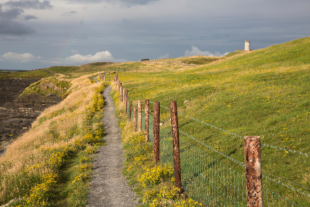 Cliffs of Moher coastal walk with Doonagore Catle, background