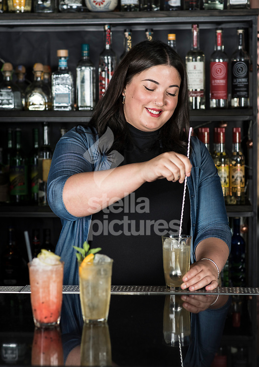 Jenny Willing mixes a Bump and Rind rum cocktail at The Curtain, Shoreditch<br /> Picture by Daniel Hambury/Stella Pictures Ltd 07813022858<br /> 24/07/2017
