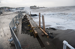 © London News Pictures. 01/02/2014. Aberystwyth, UK. Repair work to damage caused to the promenade by the last storm has been stopped. The same areas are now under threat of more damage. Waves crash on to the seafront at Aberystwyth in Wales where locals are braced for further storms battering the coastline. The seafront at Aberystwyth was badly damaged by strong storm weather just a few weeks ago. Photo credit: Keith Morris/LNP
