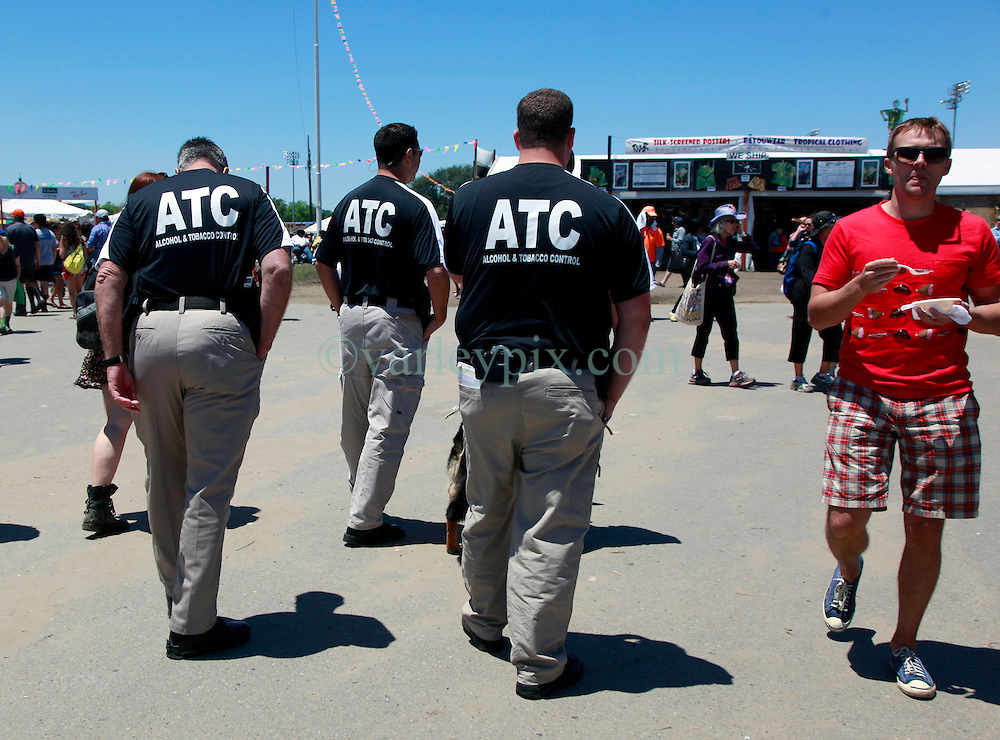 05 May 2013. New Orleans, Louisiana,  USA. .New Orleans Jazz and Heritage Festival. JazzFest..Alcohol and Tobacco control patrol the grounds in search of a time.......Photo; Charlie Varley.