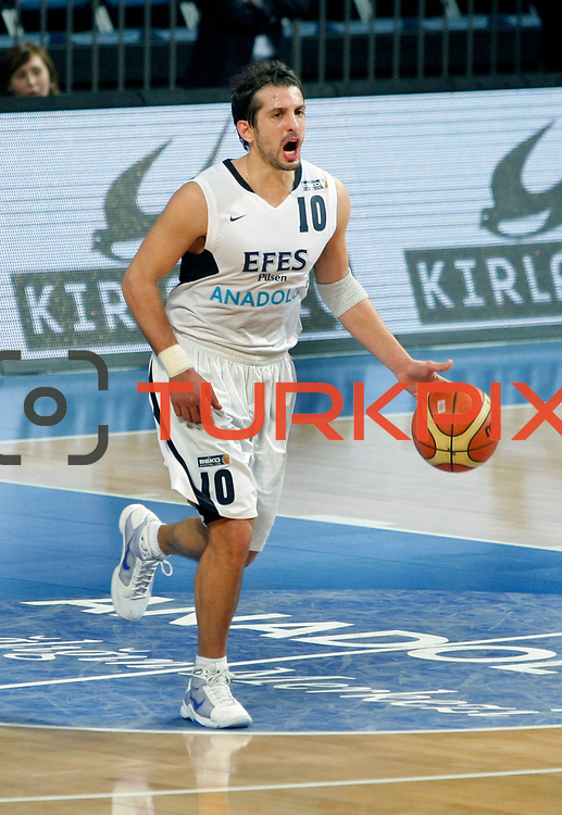 Efes Pilsen's Kerem TUNCERI during their Turkish Basketball league match Efes Pilsen between MP Trabzonspor at the Sinan Erdem Arena in Istanbul Turkey on Friday 11 March 2011. Photo by TURKPIX
