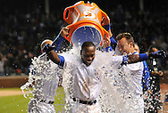 Alfonso Soriano #12 of the Chicago Cubs (L) receives a Gatorade bath from teammates Reed Johnson #5 (L) and Jeff Baker #3 after hitting a game-winning RBI single scoring Tony Campana #1 during the 10th  inning against the St. Louis Cardinals at Wrigley Field on April 24, 2012 in Chicago, Illinois. The Cubs defeated the Cardinals 3-2 in 10 innings.  (Getty Images)