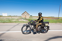 Shinya Kimura riding his Team-80 1915 Indian twin during the Motorcycle Cannonball Race of the Century. Stage-9 Dodge City, KS to Pueblo, CO. USA. Monday September 19, 2016. Photography ©2016 Michael Lichter.