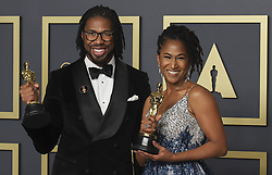 """February 9, 2020, Hollywood, California, USA: Director Matthew A. Cherry and producer Karen Rupert Toliver, winners of the Animated Short Film award for """"Hair Love,"""" pose in the press room of the 92nd Academy Awards on Sunday February 9, 2020 at the Dolby Theater in Hollywood, California. BURT HARRIS/BNS/PI (Credit Image: © Prensa Internacional via ZUMA Wire)"""
