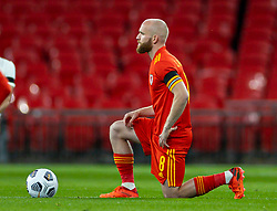 LONDON, ENGLAND - Thursday, October 8, 2020: Wales' Jonathan Williams kneels down (takes a knee) in support of the Black Lives Matter movement before the International Friendly match between England and Wales at Wembley Stadium. The game was played behind closed doors due to the UK Government's social distancing laws prohibiting supporters from attending events inside stadiums as a result of the Coronavirus Pandemic. England won 3-0. (Pic by David Rawcliffe/Propaganda)