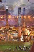 Chimney stacks appear during the 'Pandemonium'  of the Industrial Revolution which changed the face of Great Britain. These huge chimneys appeared from the ground to replace the green and pleasant land while a thousand drummers where playing under the direction of Evelyn Glennie.