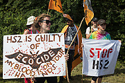 Environmental activists protest opposite a construction site for the HS2 high-speed rail link on 26th June 2020 in Harefield, United Kingdom. The activists, from HS2 Rebellion and Extinction Rebellion UK, are taking part in a 'Rebel Trail' hike along the route of the high-speed rail link from Birmingham to London in protest against its environmental impact and to question the viability of the £100bn+ project.