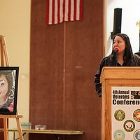 Renae Wilson speaks at the 4th Annual Veteran's Conference about her sister Hawana H. Morris (pictured), a former career consultant with the New Mexico Department of Workforce Commission who recently passed. The conference this year was dedicated to Morris.