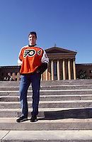 2000: Portrait of NHL ice hockey player John LeClair of the Philadelphia Flyers standing on the Art Museum steps outdoors during a private photo shoot.  Leclair is now retired from playing professional ice hockey.