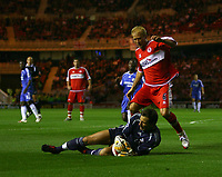 Photo: Andrew Unwin.<br /> Middlesbrough v Chelsea. The Barclays Premiership. 23/08/2006.<br /> Middlesbrough's Gaizka Mendieta (R) is beaten to the ball by Chelsea's goalkeeper, Carlo Cudicini (L).