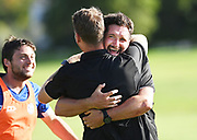 Hamilton Wanderers staff celebrate making the top 4 and the finals. ISPS Handa Men's Premiership football match between Eastern Suburbs AFC and Hamilton Wanderers at Madills Farm in Auckland. Sunday 21 February 2021. © Coyright image by Andrew Cornaga / www.photosport.nz