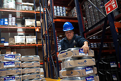 A worker stacks material at a Grupo Sanchez ink factory in Mexico City, Mexico.