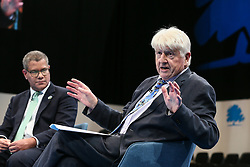 © Licensed to London News Pictures. 05/10/2021. Manchester, UK.  COP26 President Alok Sharma holds a discussion with Stanley Johnson, father of Prime Minister Boris Johnson, at the Conservative Party Conference on Tuesday. The annual Conservative Party Conference has returned to Manchester this year after being held online in 2020. Photo credit: Adam Vaughan/LNP