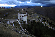 A church stands isolated from other buildings in the small town of Rocca Calascio, close to Santo Stefano di Sessanio in the province of L'Aquila in Abruzzo, inside the national park of the Gran Sasso e Monti della Laga, Italy, September 6, 2016. Santo Stefano di Sessanio counts a population of 114 inhabitants, the lowest in the history of the town. Many of it's inhabitants emigrated abroad or in larger cities in Italy in search for work. The people that have stayed behind are determined to bring back the town to life by regenerating the local economy. REUTERS/Siegfried Modola