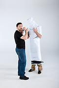 Karl Pilkington (Bald Head, Grey top, wrapped in paper. ), Ricky Gervais ( Black T)