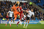 Sean Morrison of Cardiff city © puts pressure on Rotherham goalkeeper Adam Collin.  Skybet football league championship match, Cardiff city v Rotherham Utd at the Cardiff city stadium in Cardiff, South Wales on Saturday 6th December 2014<br /> pic by Andrew Orchard, Andrew Orchard sports photography.