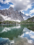 Lake Coldai reflects Monte Civetta (3220 meters or 10,564 feet elevation) in the Dolomites, Belluno province, Veneto region, Italy. From Alleghe village, take a scenic lift to hikes on impressive Monte Civetta. The Dolomites or Dolomiti are part of the Southern Limestone Alps in Europe. UNESCO honored the Dolomites as a natural World Heritage Site in 2009. This panorama was stitched from 5 overlapping photos.