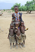 Africa, Ethiopia, Omo valley, a family of the Arbore tribe woman with three children