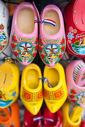 Painted clogs for sale in tourist souvenir shop in Amsterdam Netherlands