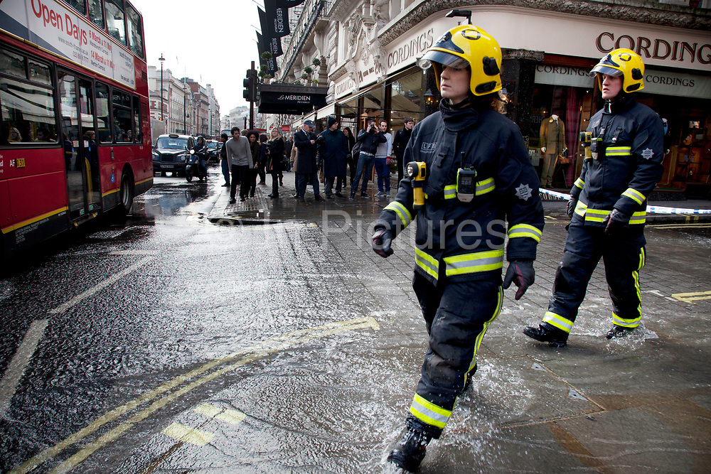 London, UK. Saturday 2nd March 2013. Burst water main causes flooding disruption in central London. Emergency services on hand at the scene on Piccadilly.