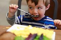 two year old boy enjoying eating