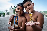 Cuban boys outside the church of El Cobre. Santiago de Cuba. Cuba.