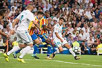 Real Madrid's Karim Benzema and Marco Asensio and Valencia's Geoffrey Kondogbia during La Liga match between Real Madrid and Valencia CF at Santiago Bernabeu Stadium in Madrid, Spain August 27, 2017. (ALTERPHOTOS/Borja B.Hojas)