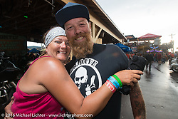 Melissa Shoemaker and Bill Dodge at the Iron Horse Saloon during the annual Sturgis Black Hills Motorcycle Rally.  SD, USA.  August 8, 2016.  Photography ©2016 Michael Lichter.