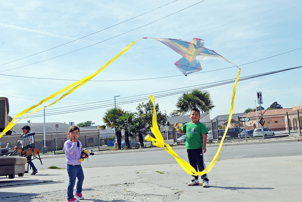 """Carlos Mejia, 6, and a friend fly his """"papalote,"""" or flying kite, under the power lines near Jesse Sanchez Elementary School in east Salinas."""