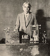 Jagadis Chandra Bose (1858-1937) Indian botanist and physicist, demonstrating electrical changes in plant stems (1926).  Halftone from a photograph.