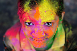 March 13, 2017 - Allahabad, Uttar Pradesh, India - An Indian girl smeared with colored powder smiles at the camera during the Holi festival celebration in Allahabad.  (Credit Image: © Prabhat Kumar Verma via ZUMA Wire)