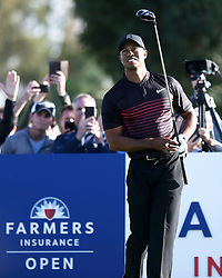 January 25, 2018 - San Diego, California, United States - Tiger Woods watches his tee shot off the 18th hole during the first round of the 2018 Farmers Insurance Open at Torrey Pines GC. (Credit Image: © Debby Wong via ZUMA Wire)