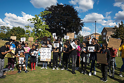 Slough, UK. 13 June, 2020. Young people hold signs bearing the names of people, most of whom died in police custody, during a peaceful protest in solidarity with the Black Lives Matter movement on 13th June 2020 in Salt Hill Park in Slough, United Kingdom. Protests in solidarity with the Black Lives Matter movement have taken place across the United States and in many countries around the world.