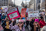 """San Francisco, USA. 19th January, 2019. At the Women's March San Francisco, marchers smile with their protest signs calling to """"impeach"""" and """"overturn"""" President Donald Trump. Credit: Shelly Rivoli/Alamy Live News"""